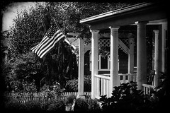 Home with American Flag on porch