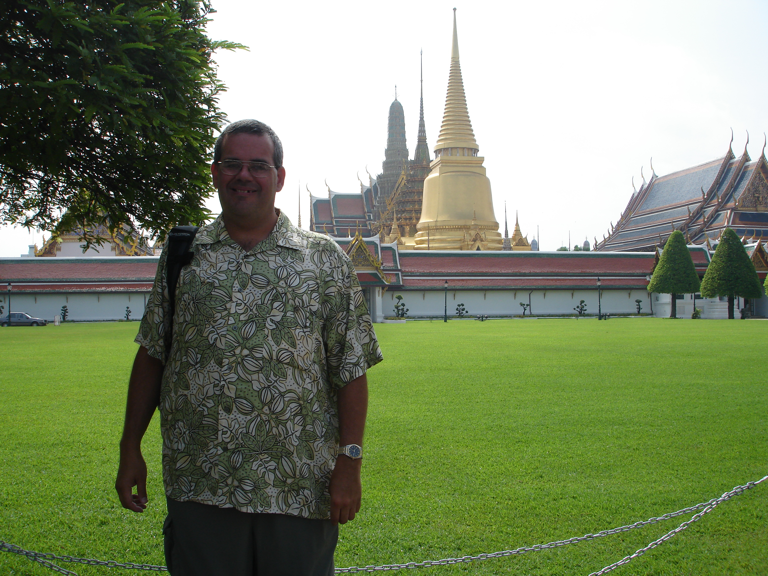 Mark Jochim (me!) at the Grand Palace in Bangkok with the same view behind me as portrayed on Scott #561 issued in 1970. Photo taken by Sangwan Saethem on May 17, 2006.