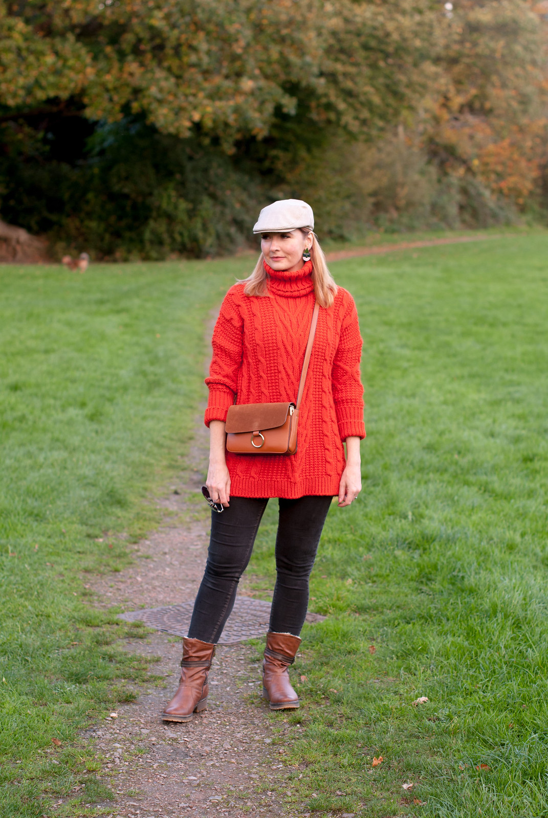 Cozy, comfy autumn fall outfit for walking the dog  long orange-red roll neck sweater  skinny jeans  brown ankle boots  flat cap | Not Dressed As Lamb, over 40 style