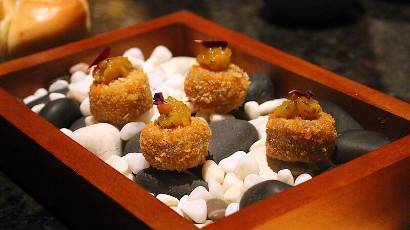 Amuse bouche of salmon croquettes