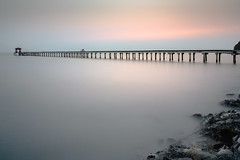 Wooden bridge in the beautiful view on sea at sunset