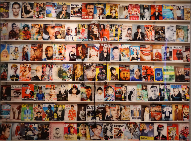 Liu Bolin-Hiding in the city-London 04-Magazine Rack, 2014