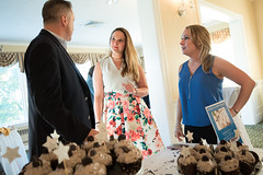 """State Representative Stephanie Cummings talks with State Auditor Rob Kane and Lindsay Verardo during the Champagne and """"Celebrity"""" Cupcakes Auction held at the Country Club of Waterbury. Rep. Cummings unveiled the """"Water Berry"""" cupcake - a rosé cupcake with a raspberry filing and homemade butter cream frosting."""