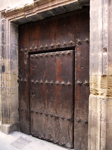 The 15th century monastery in Najera, Spain is worth seeing for its many interesting architectural features such as this heavy-duty old wooden door