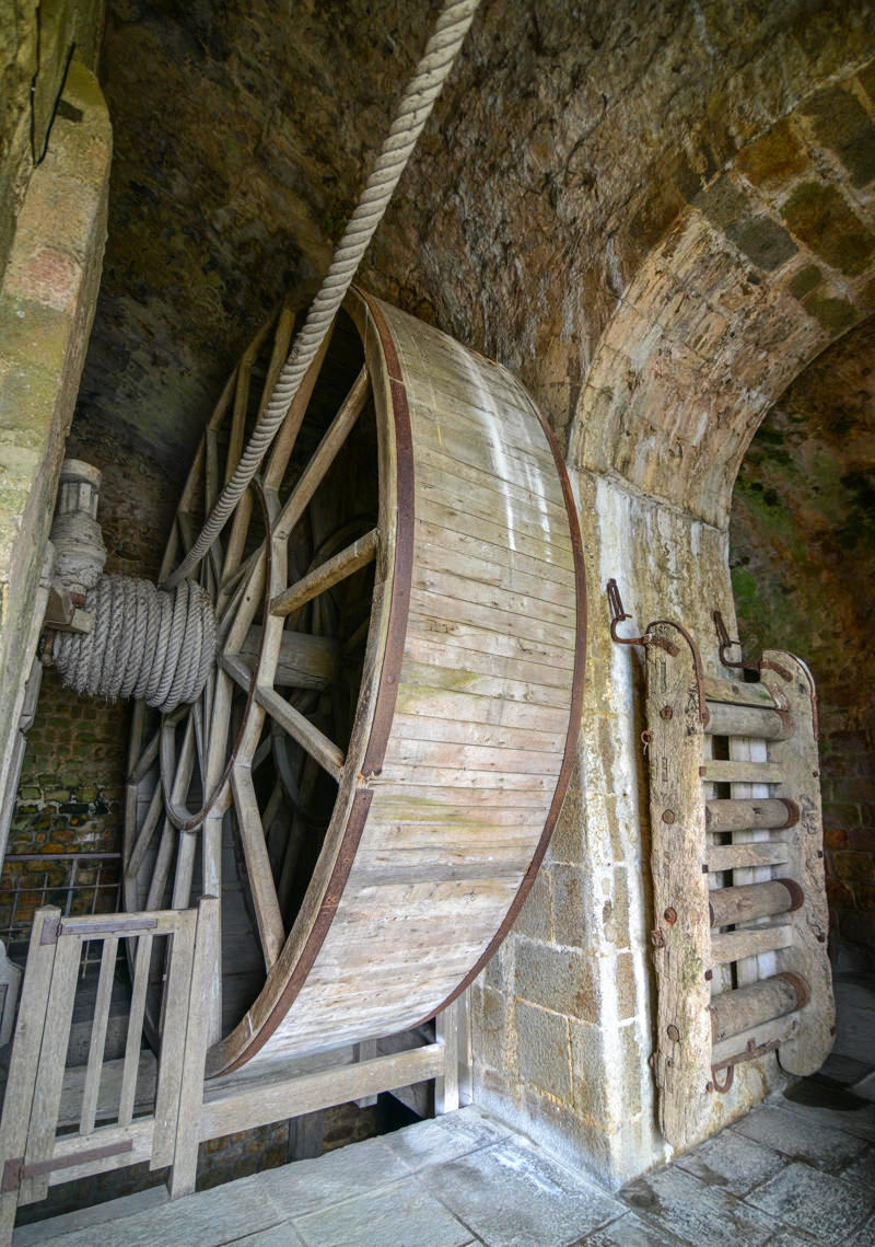 Treadwheel crane served as a windlass, installed when Mont Saint-Michel was a prison, to bring supplies prisoners. Some prisoners would walk inside the wheel to rotate it. Credit Jorge Láscar