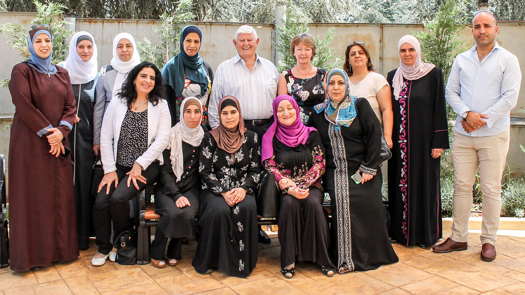 Professor Mary Hayden and Professor Jeff Thompson standing with teachers from the Queen Rania Teacher Academy