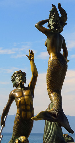 Sculptures of a merman & a mermaid along the Malecon (seawall) in Puerto Vallarta in Mexico
