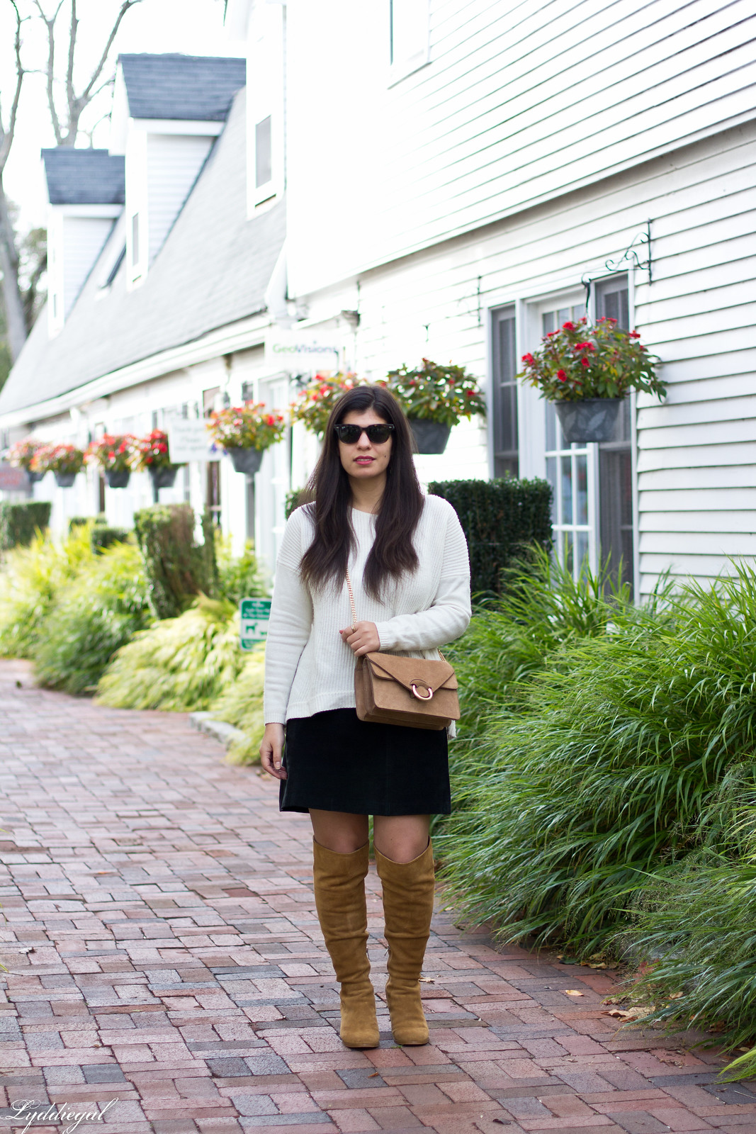 white sweater, black mini skirt, over the knee boots.jpg