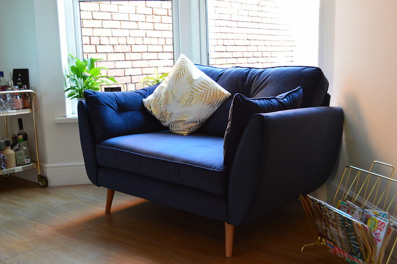This is a picture of the dfs zinc sofa in navy blue velvet