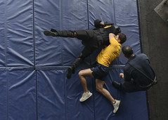 Sailors participate in an oleoresin capsicum spray qualification course.