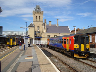Photograph of Lincoln station with two single class 153s waiting in the platforms
