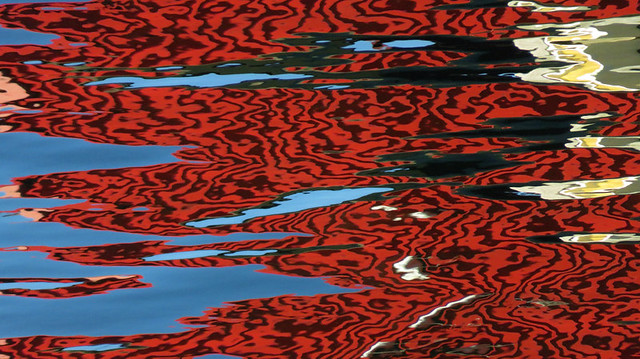 Red ripple reflection on the water at Horseshoe Bay in Canada