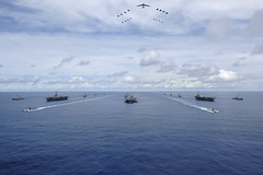 In this file photo, the USS Nimitz (CVN 68), USS Kitty Hawk (CV 63) and USS John C. Stennis (CVN 74) carrier strike groups steam in formation during exercise Valiant Shield 2007. (U.S. Navy/MCSN Stephen W. Rowe)