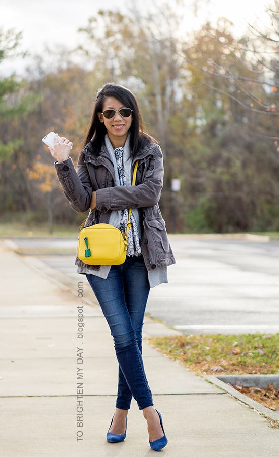 gray military jacket, gray open cardigan sweater, floral embroidered peplum top, yellow crossbody camera bag, skinny jeans, blue suede pumps