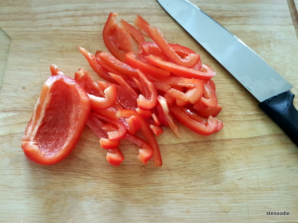 cutting red bell peppers