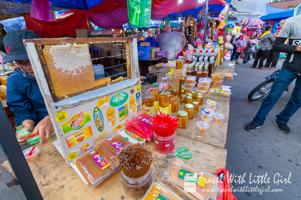 Man selling honey at Pasar Malam, Cameron Highlands