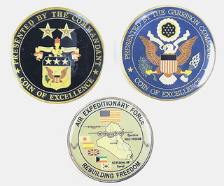 Three military challenge coins