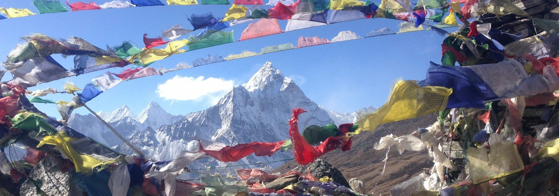 1478260855-1478260772-view_of_everest_through_prayer_flagsjpg
