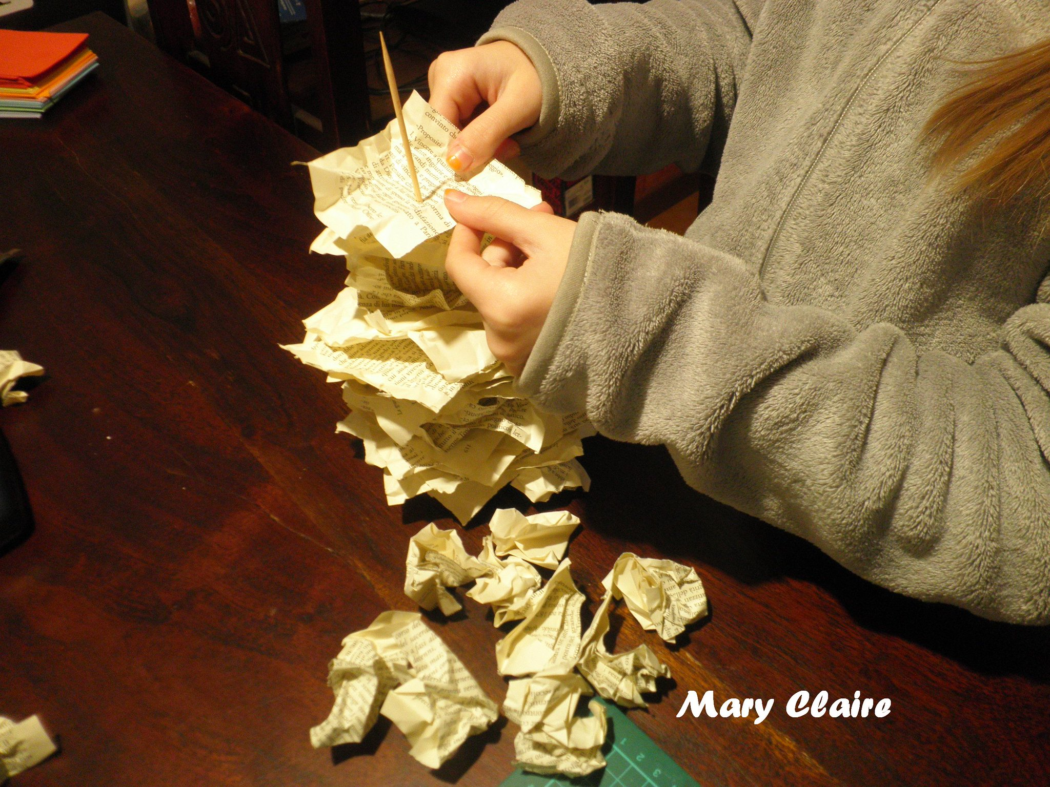 infilare quadrati di carta