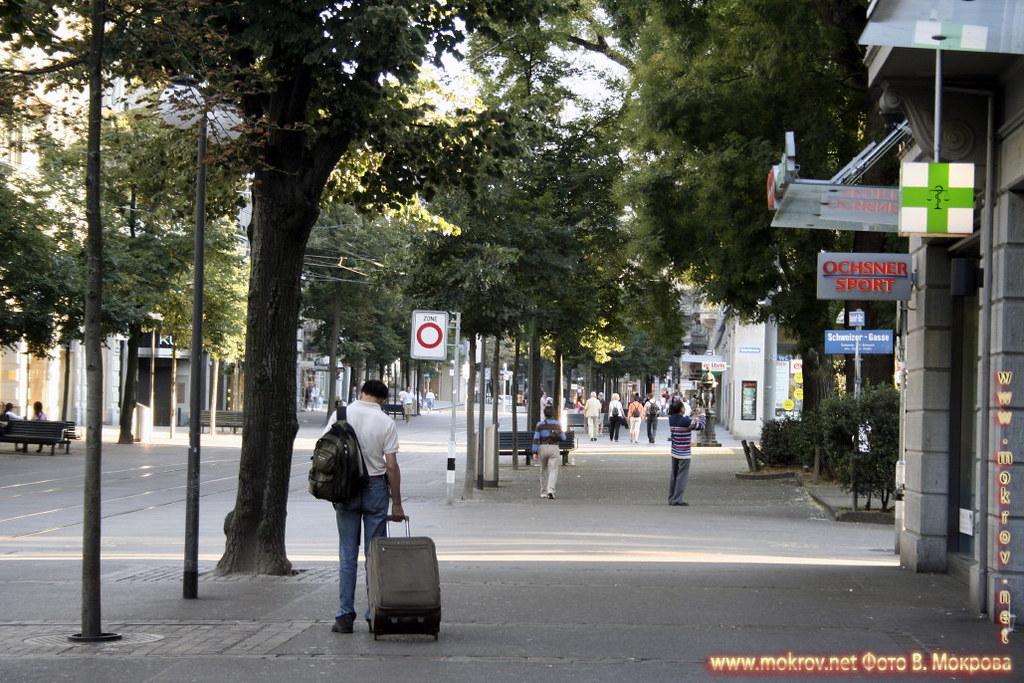 Улицы в городе Цюрих и фотограф