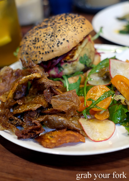 Potato skins and salad with the falafel cheeseburger at Two Chaps vegetarian cafe in Marrickville