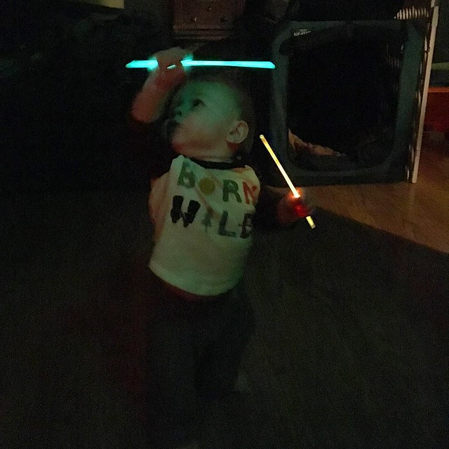 A proud moment for this former raver: baby's first glow sticks.