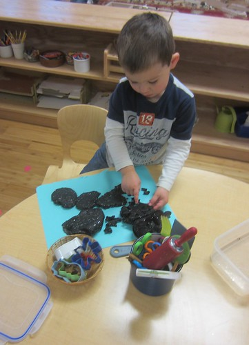 Black sparkly play dough shapes