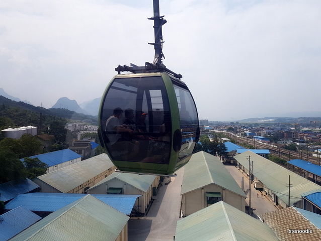 cable car above houses