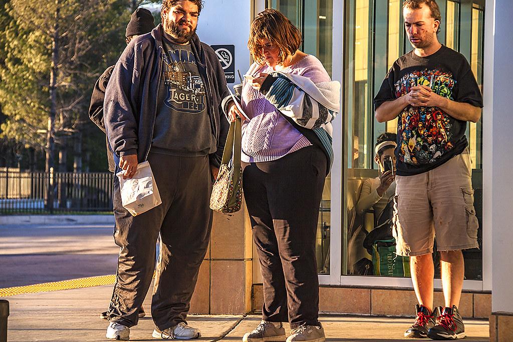 Three people outside bus station--Scranton