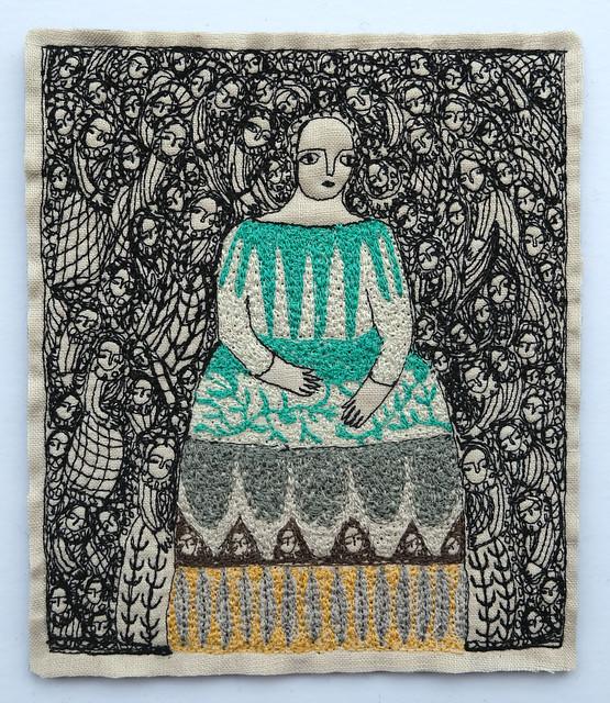 a folk figure in stitch
