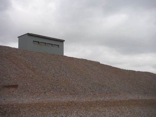 Dungeness Bird Hide on Tsunami Defence Shingle Wall