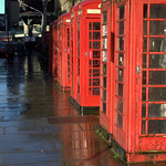 Row of red telephone boxes