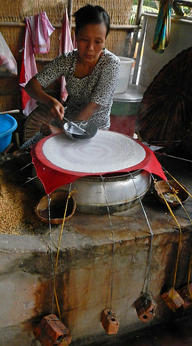 Making a huge rice paper cracker at the snack factory on the Mekong River in Vietnam