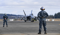 In this file photo, Electronic Attack Squadron (VAQ) 142 aircraft return home to Naval Air Station Whidbey Island earlier this month following a deployment aboard USS Nimitz (CVN 68). ((U.S. Navy/MC2 Joseph E. Montemarano))
