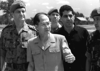 Yasushi Akashi, the head of UNTAC - to his right is Lieutenant General John Sanderson, the military head.