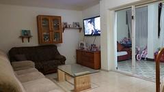Gran salón comedor con terraza acristalada, muy amplio y soleado. En su inmobiliaria Asegil en Benidorm le ayudaremos sin compromiso. www.inmobiliariabenidorm.com