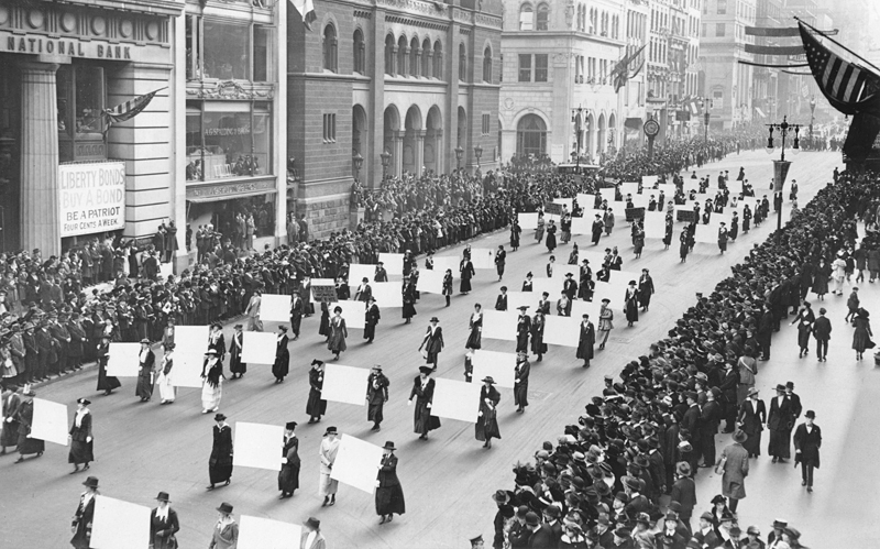 Suffragists march down New York City's Fifth Avenue in October 1917, displaying placards containing the signatures of more than one million New York women demanding the vote.