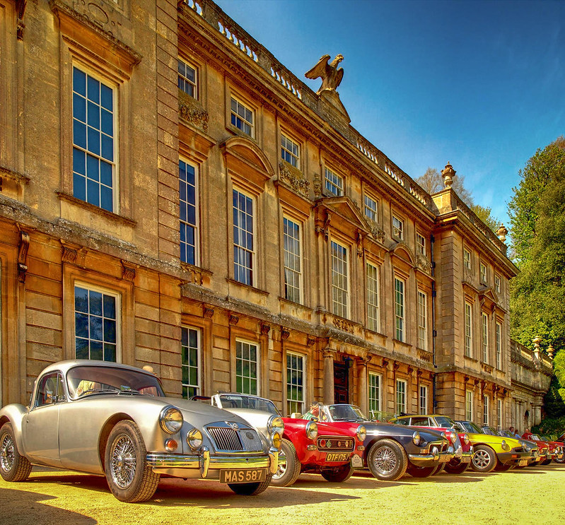 Dyrham Park mansion in Gloucestershire hosting an MG Owners Club meet. Credit Anguskirk, flickr
