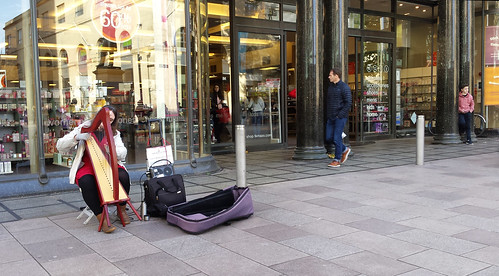 Busker with harp