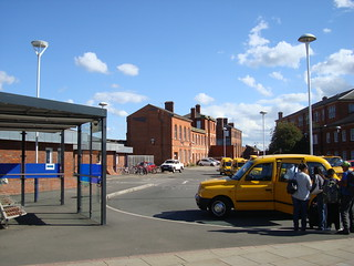 Photo of the taxi-rank area outside Derby station with Network Rail buildings in the background