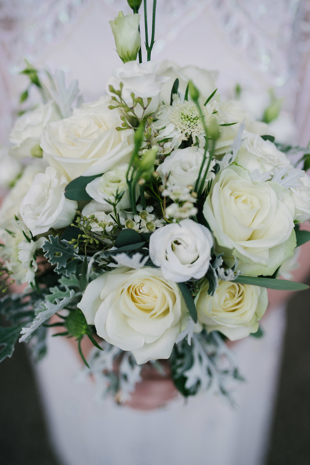 this is a picture of a wedding bouquet with white roses