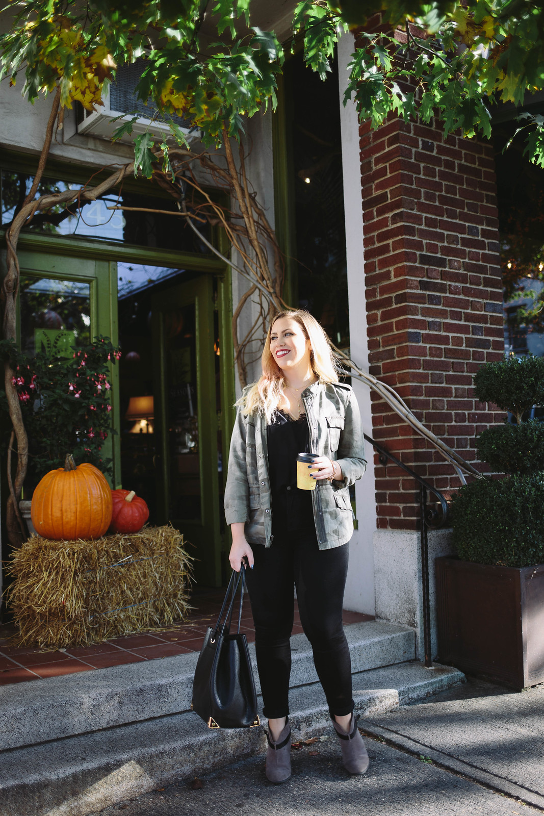 Coffee Date Outfit Fall Weather Pumpkin Haystack Camouflage Jacket Black Skinny Jeans
