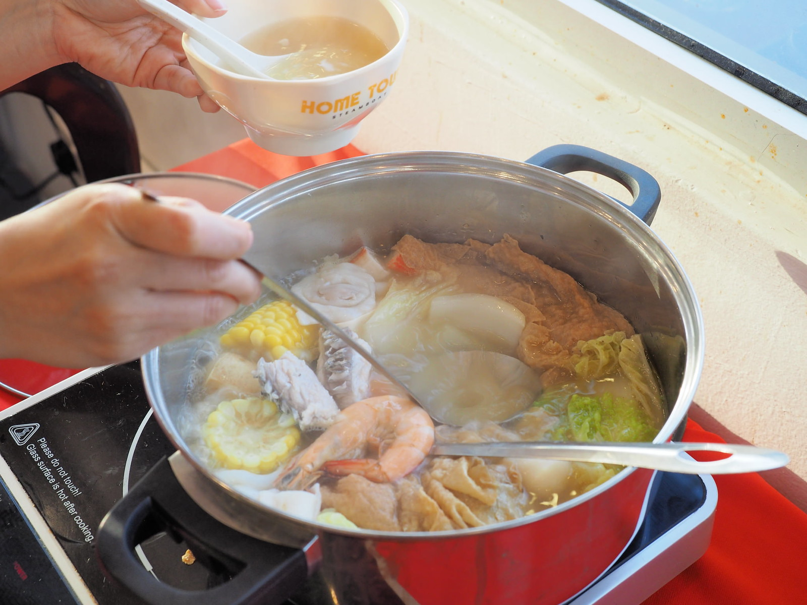 Taking the soup from the steamboat