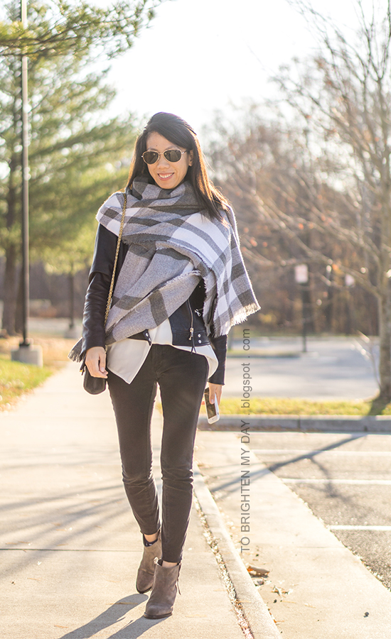 oversized plaid blanket scarf, black leather jacket, silk button up shirt, black shoulder bag, black skinny jeans, gray suede ankle boots