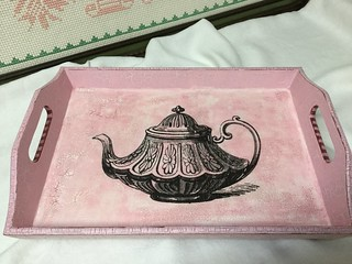 Pink tray with a vintage tea pot design.