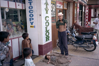 Internally Displaced People -IDPs - and an amputee begging in downtown Phnom Penh in 1993.