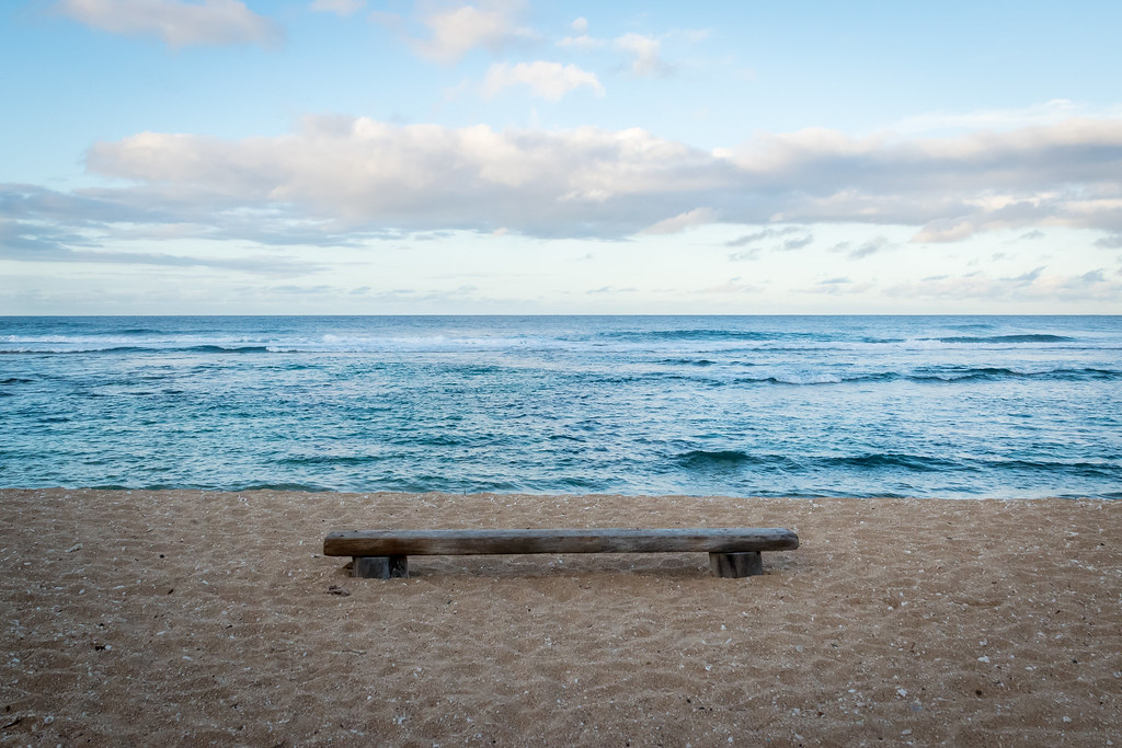 a lone bench on the sand at Larsen's Beach
