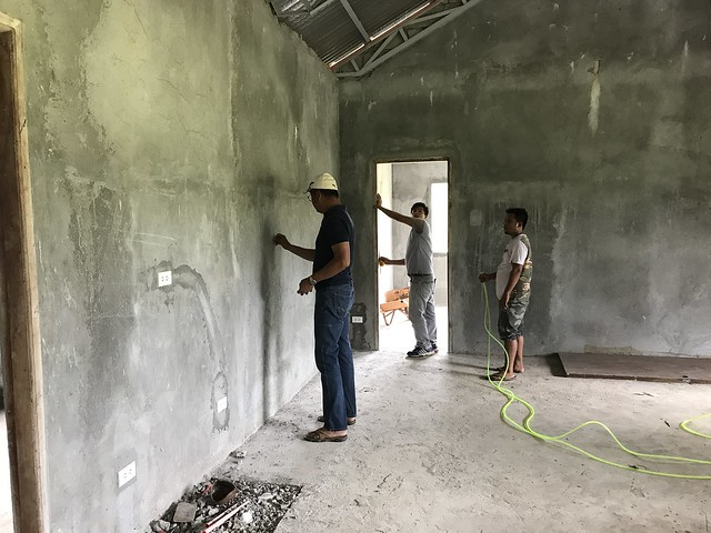 unfinished cottage house,  workers