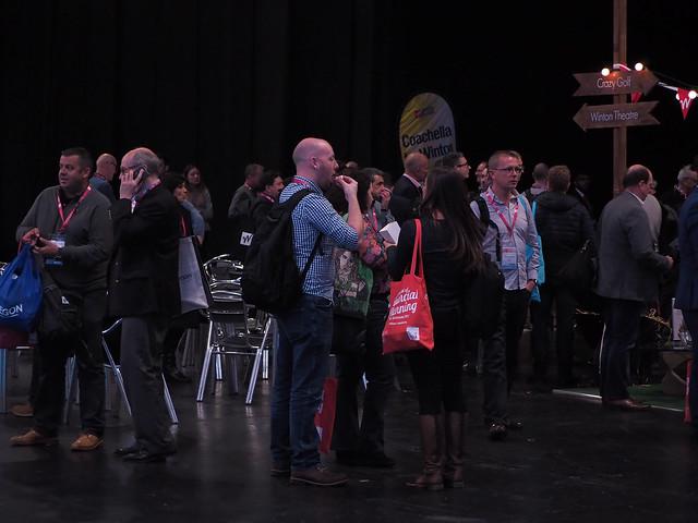 Delegates chatting outside one, Olympus PEN-F, Lumix G Vario 45-200mm F4.0-5.6 Mega OIS