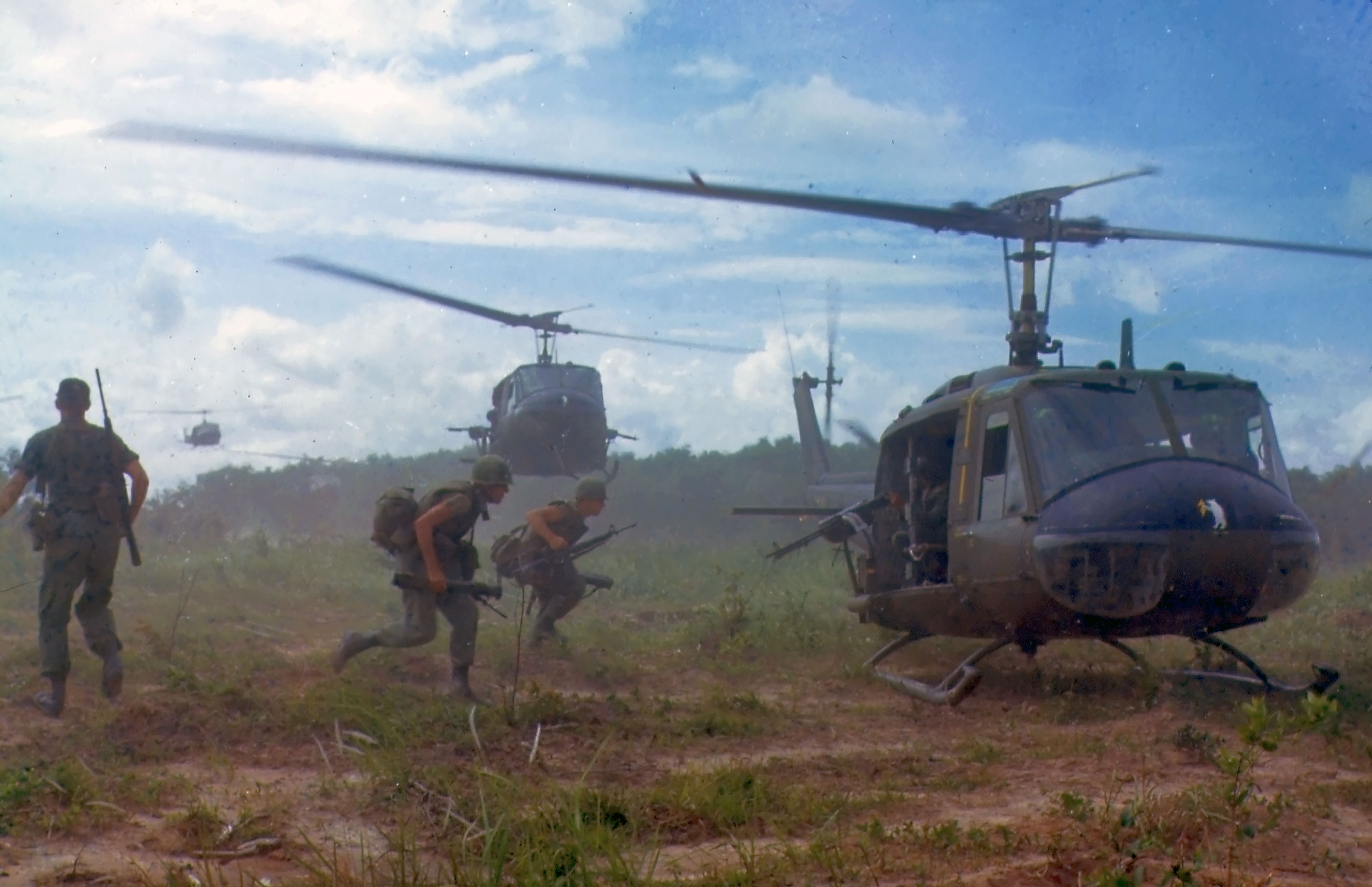 U.S. Army Bell UH-1D helicopters airlift members of the 2nd Battalion, 14th Infantry Regiment from the Filhol Rubber Plantation area to a new staging area, during Operation